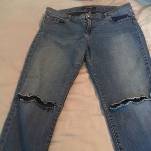 J BRAND jeans in medium wash with rips at knees